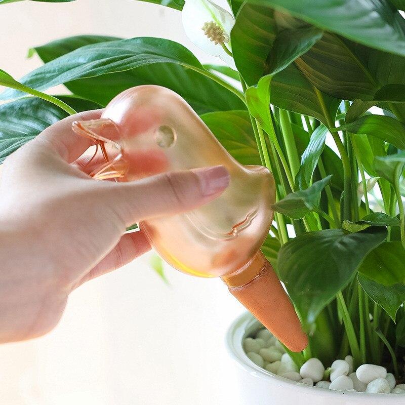 1 ppiezas Linda forma de pájaro automático planta de riego equipo creativo planta riego accesorios de jardinería Envío Directo