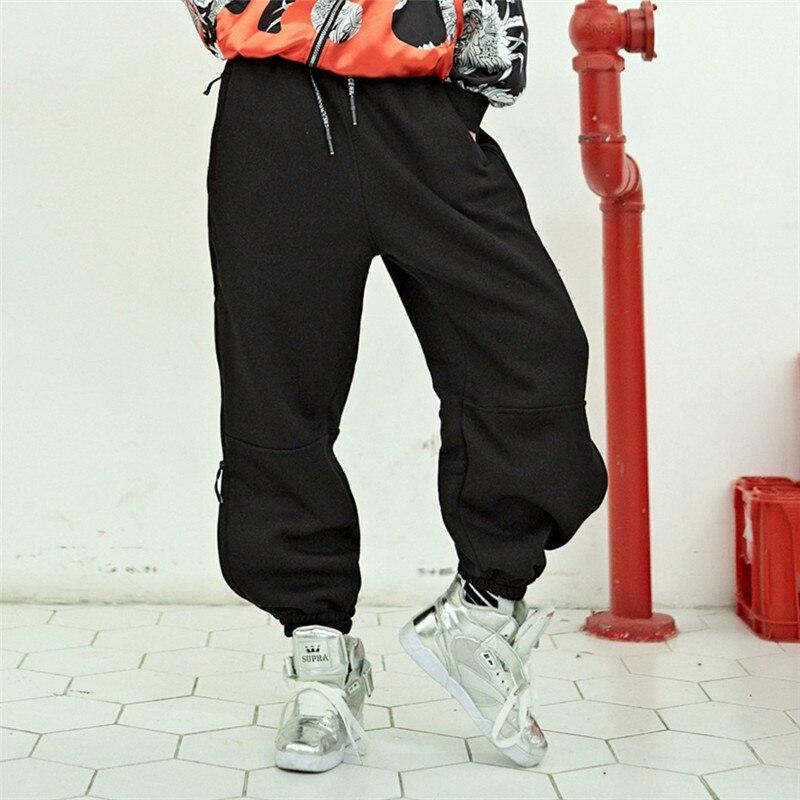 Femmes hip hop pantalon côté serpent coton taille élastique côté fermeture éclair rayure plissée rivet noir pantalon pull skateboard pantalon