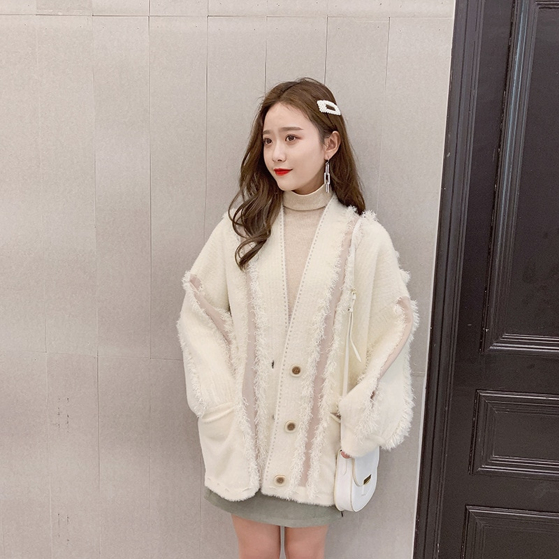 Spring and Autumn New Broken Hole Tassel Seater Women's Puff Sleeve Cardigan enlarge