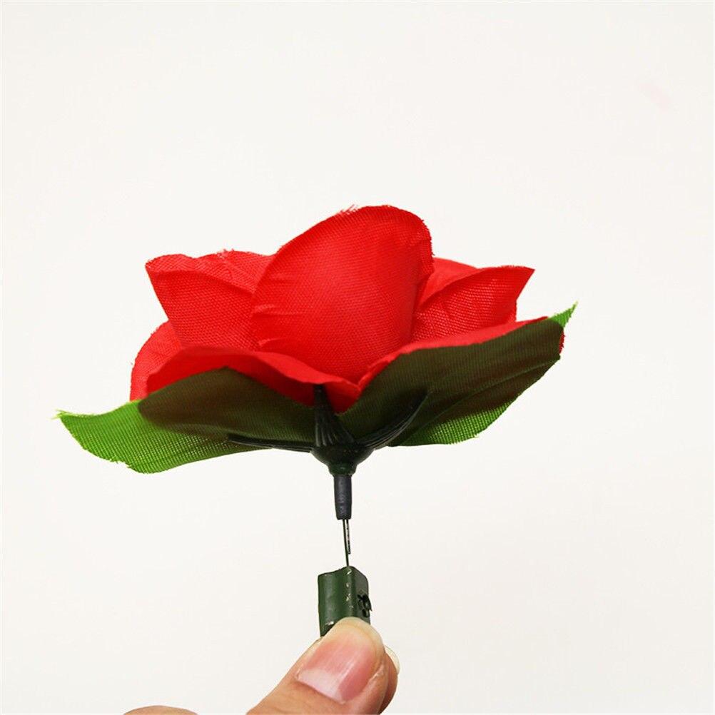 1 pçs tocha rosa flor para fogo truques chama novidade fase perto truque mágico