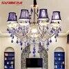 Lustre en fer et cristal design moderne éclairage d'intérieur luminaire décoratif de plafond idéal pour un salon ou une chambre à coucher
