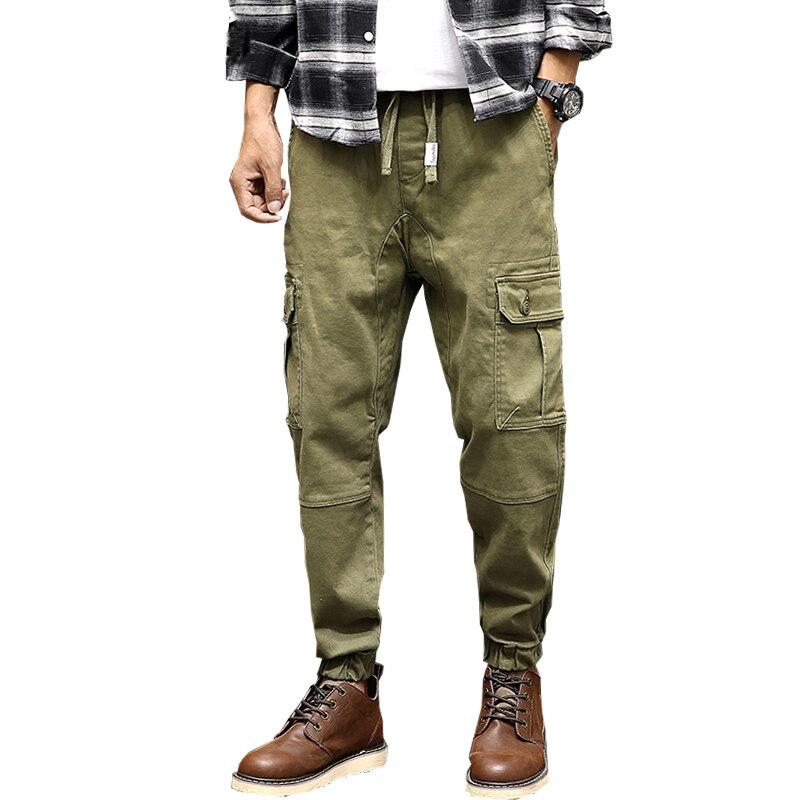 Envío de la gota de la nueva llegada de los hombres pantalones de combate militar pantalones grandes pantalones de ejercicio con bolsillo M-3XL XP50