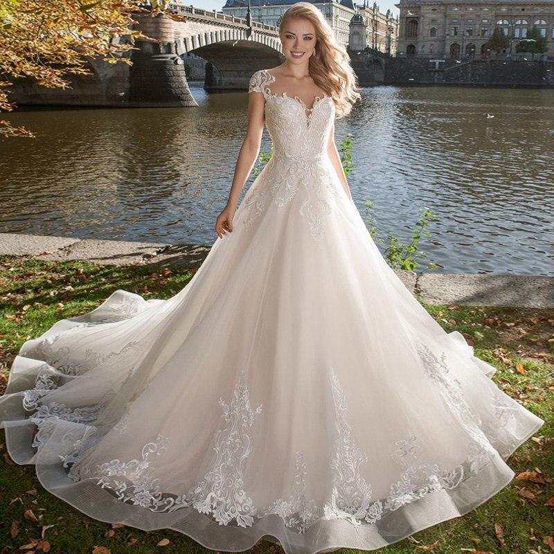2020 Bohemian Wedding Dresses Jewel Lace Satin Bridal Gowns Button Back Beach Cap Sleeves A-Line Wedding Dress Robe De Mariee