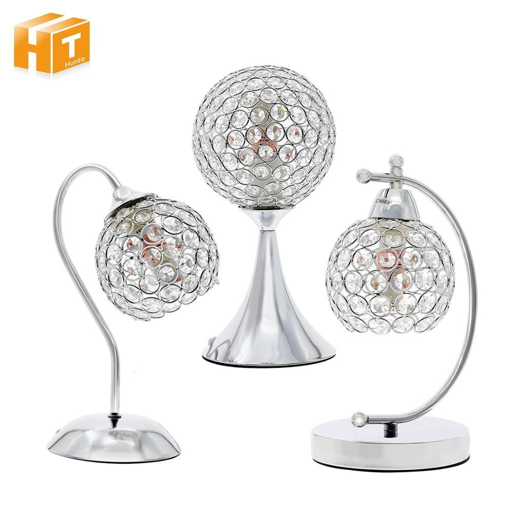 Lámpara de mesa de cristal moderna al lado de la luz de...