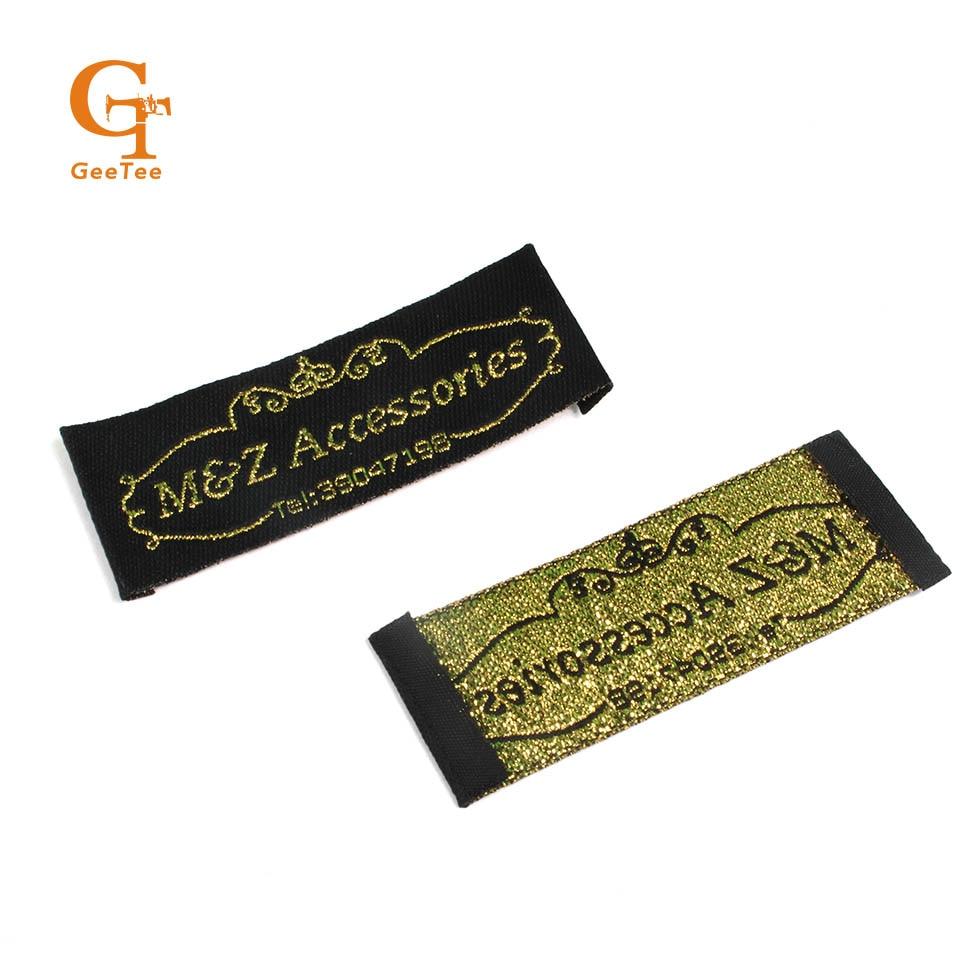 Etiquetas de ropa tejido para ropa, bolsos/vestido de mujer/bufandas de juguete etiquetas para nombre de marca, fondo negro con logo dorado, corte recto