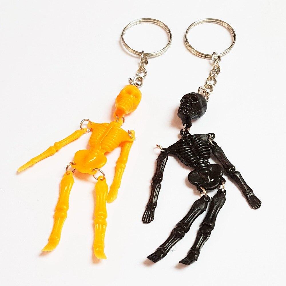 12 Unid 9 cm negro y naranja movimiento esqueleto llavero Halloween Recuerdos de una fiesta carnaval pinata bolsa Goody relleno novedad regalo carniva