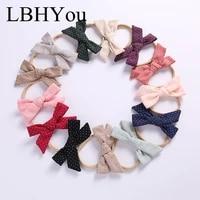 13pcslot handmade hand tie cotton nylon headbandscross print knot bows elastic nylon head bandsnewborn baby bowknot hairbands