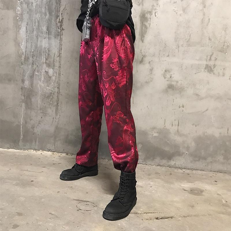 Estilo chino primavera y otoño pantalones de mujer dragón bordado bolsillo casual pantalones sueltos fondo plano completo lana pantalones