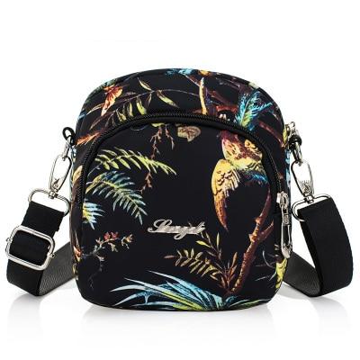 Nouveau mode sacs à main Shopping unisexe! porte-épaule et sac à main tout-match gaufrage chaud Top polyvalent Nylon petit transporteur