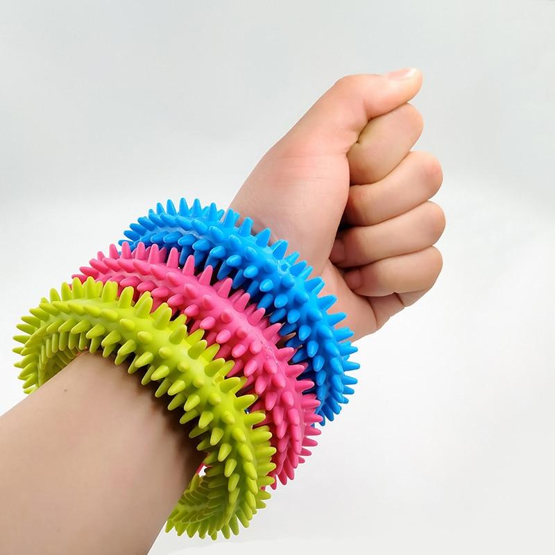 Nuevo anillo táctil sensorial Spiky para niños, pulsera de masaje para terapia de autismo, juguetes sensoriales para adultos para reducir el estrés, regalos para niños