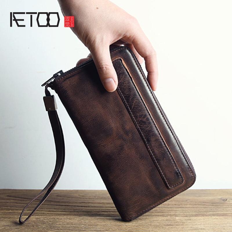 AETOO Homens carteira masculina carteira de couro é o saco de mão da marca pacote de saco de mão de pele de carneiro retro longa seção zíper saco de estudante vindima