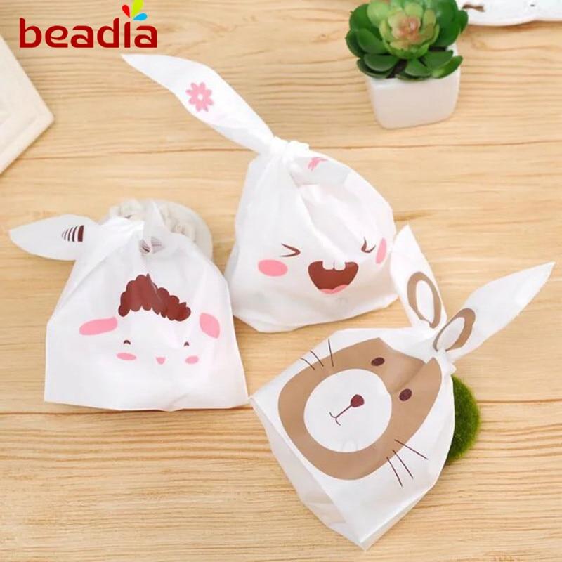 Nuevas 50 Uds. 13,8x22 cm orejas largas encantadoras bolsas de plástico caramelo galleta refrigerio bolsas conejo oveja oso fiesta diseño suministros