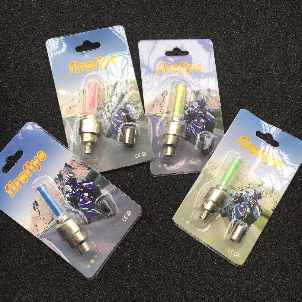 Fireflys ruedas de coche calientes bicicleta sensor para motocicletas de cubiertas para válvula de neumático Válvula de ruedas centrales de neón stick Luz de lámpara LED