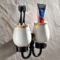 black oil rubbed bronze wall mounted toothbrush holder with two ceramic cups wba472