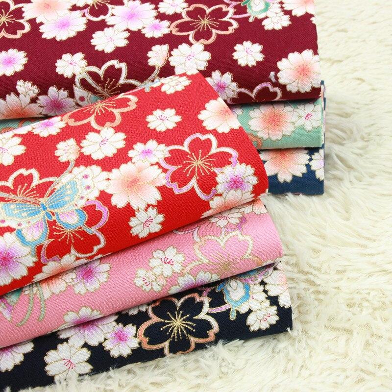 Media yarda de tela gruesa de algodón suave con estampado de mariposa dorada, bolsa hecha a mano para manualidades, ropa de vestir, tela 100% algodón B118