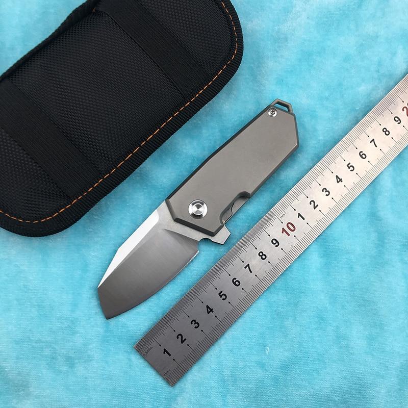 NF01 nuevo cuchillo plegable abatible D2 cojinete de hoja de titanio mango de aleación al aire libre camping cuchillo de fruta EDC herramienta