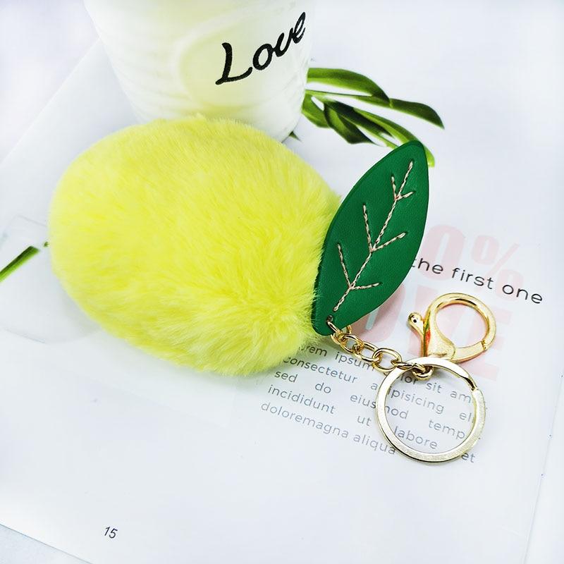 Nouveau mangue vert cheveux ampoule porte-clés décoration imitation cheveux artificiels dame sac voiture clé fruit cheveux ampoule alliage pendentif