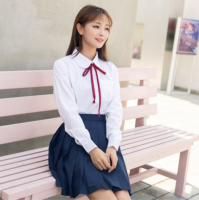 Uniforme Escolar de estilo japonés coreano para chicas, traje de manga larga, camiseta blanca, Top azul marino, Falda plisada con lazo rojo