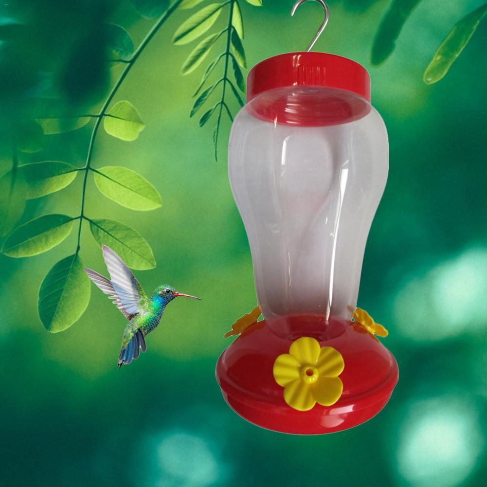 Nuevo alimentador de agua para pájaros de plástico caliente, alimentador de colibrí colgante para jardín, alimentador de pájaros con gancho de hierro de plástico para exteriores