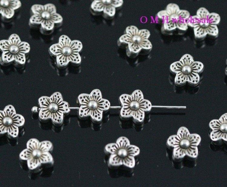 OMH wholesale Free ship 18pcs tibetan silver flower spacer beads Jewelry metal beads 8.5X4.5mm ZL201