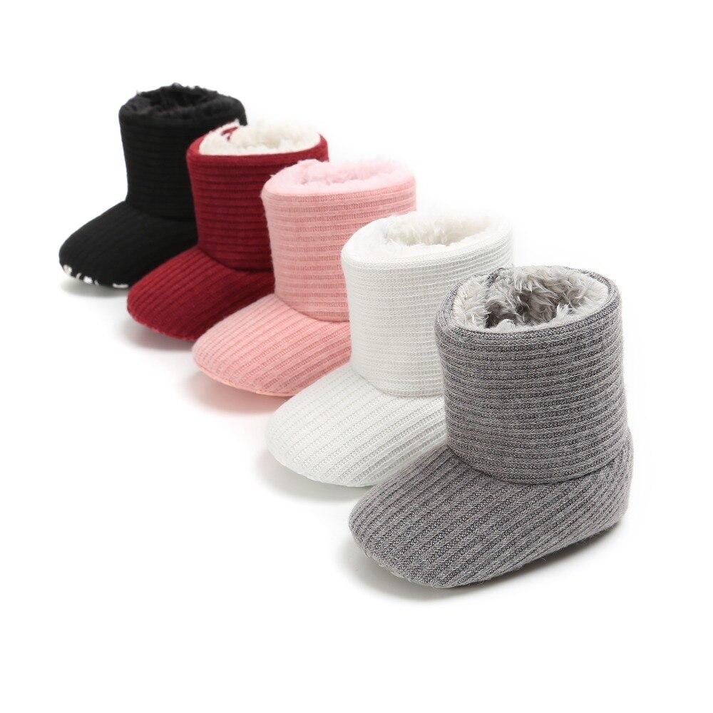 Botas de bebé de estilo de moda con nudo mariposa de delibao, zapatos de invierno de departamento de invierno para bebés con diseño de moda único para invierno