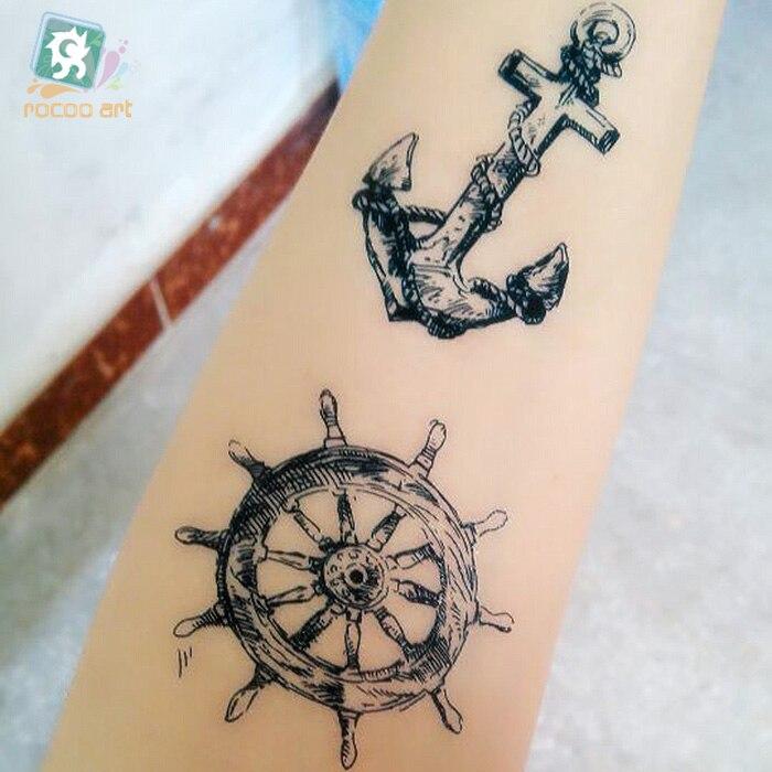 Nuevo 2019 negro tradicional Tribal falso tatuaje temporal pegatina Cuerpo impermeable tatuaje de calavera flecha pistola para hombres y mujeres