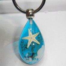Nouveauté porte-clés souvenir créatif étoile de mer lumineuse porte-clés mode voyage punk métal résine porte-clés filles cadeau