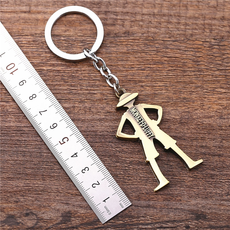 Julie 10 unids/lote llavero de una pieza mono D figura de luffy modelo marrón aleación Soporte para Llavero joyería para disfraz porte clef Chaveiro