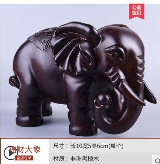 Madera maciza Victoria ébano crisantemo pera tallado elefante poner elefante auspicioso un objeto madera sólida éxito estatua
