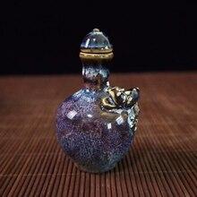 Antique porcelain kiln turned blue glaze embossed dragon snuff bottle