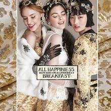 Exclusivo brocado avanzado jacquard oro hilo irregular brillo moda tela de vestido al por mayor de alta calidad de tela