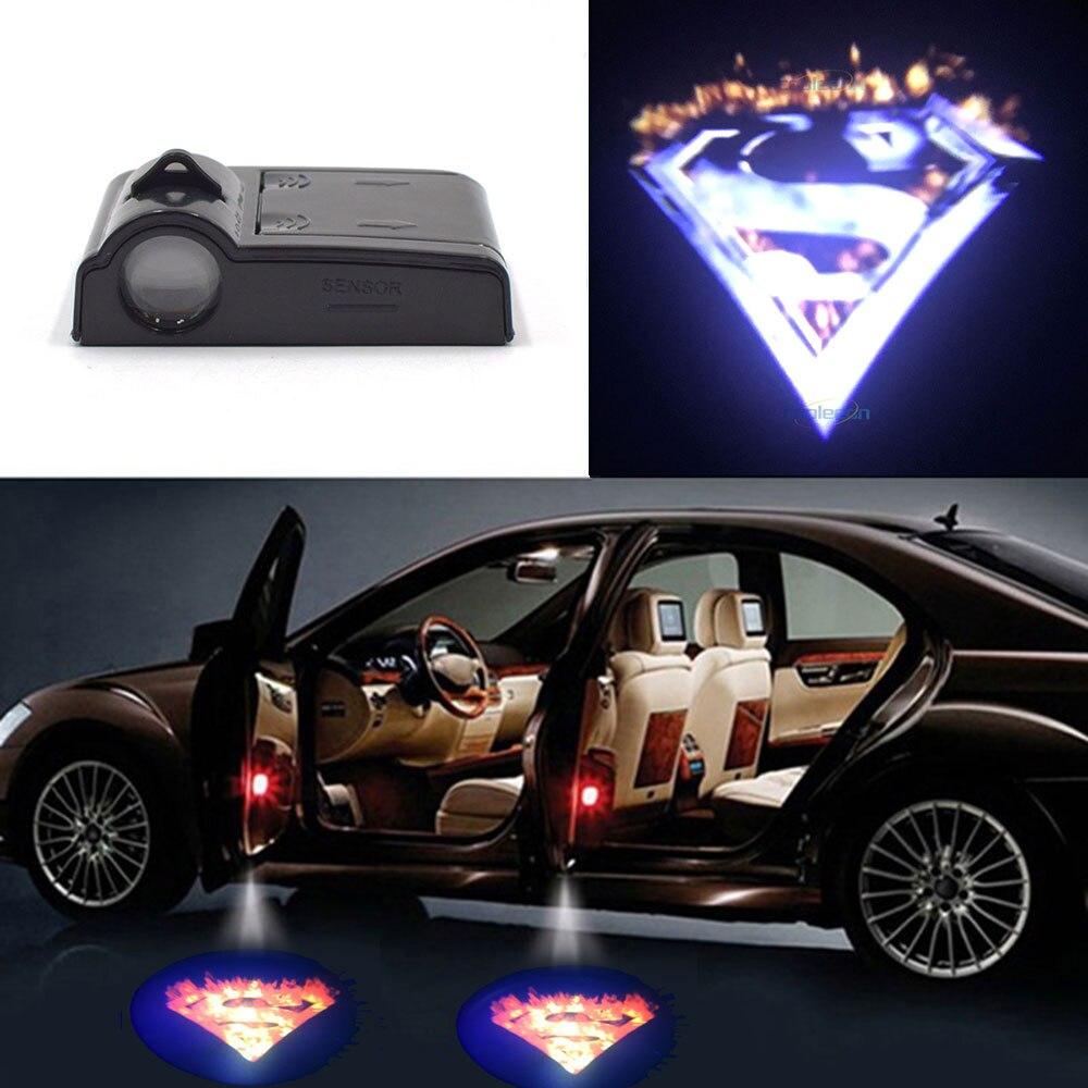 Proyector con logotipo de Superman, luz, sombra, fantasma, proyector, bombilla LED para puerta de coche, lámpara de bienvenida, Control inalámbrico, alimentado por batería
