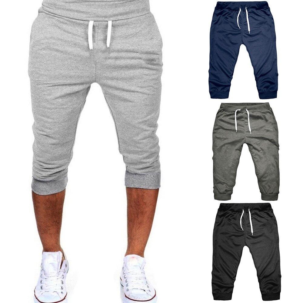 MANVIE verano hombres gimnasio entrenamiento Jogging pantalones cortos ajuste elástico Casual ropa deportiva pantalones cortos hombres pantalones Joggers 9,14