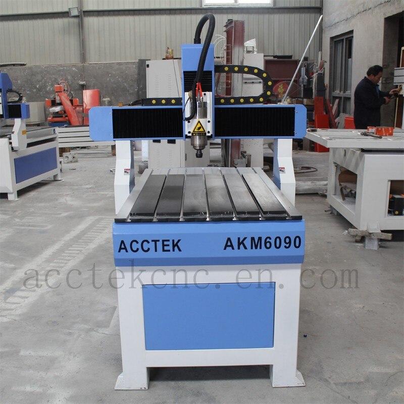 China 6040 mini 6090 3 eje 4 ejes cnc router maquinaria de grabado 3d cnc máquina de tallado de madera para la venta
