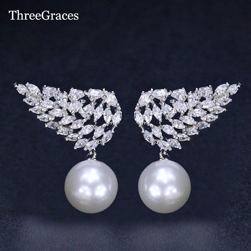ThreeGraces Hada vuelo ala simétrica diseño brillante Zirconia cúbica perla cuelga pendientes gota para novia para la boda ER131