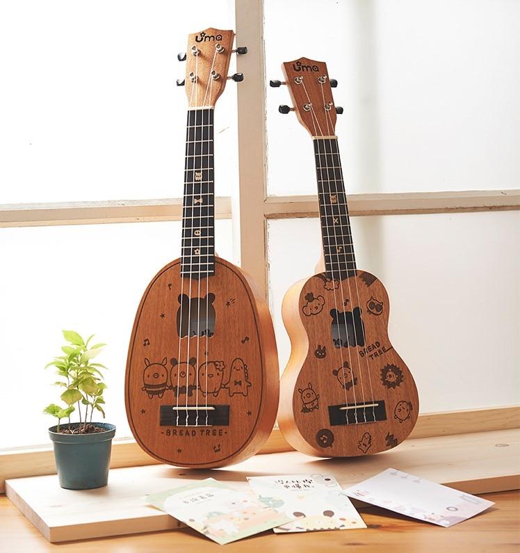 أوما-سلسلة شجرة الخبز ، الماهوجني ، القيثارة ، 21 بوصة سوبرانو أو 23 بوصة حفلة موسيقية ، أيضا في شكل الأناناس مع علبة ناعمة