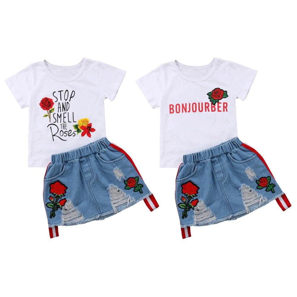 Moda nueva ropa de verano para niños y niñas, camisetas de manga corta con flores + conjunto de 2 Uds de Falda vaquera con orificios y rosas bordadas