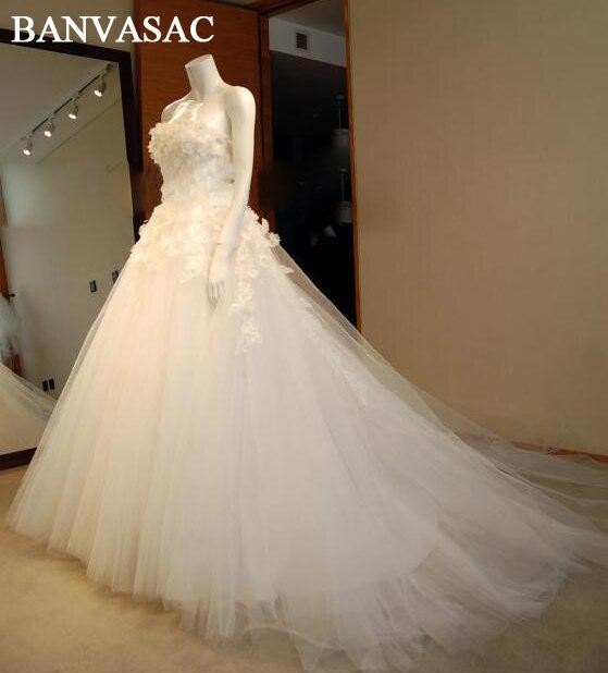 BANVASAC-فستان زفاف أنيق بدون حمالات مع زهور ، فستان زفاف ساتان فاخر بدون أكمام مع ذيل ، 2017