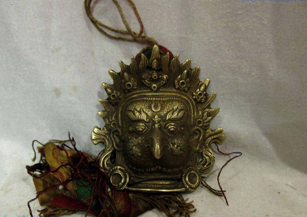 Estatua de la escultura de la placa colgante de Buda cabeza de goshawk del budismo tallado de cobre del Tíbet