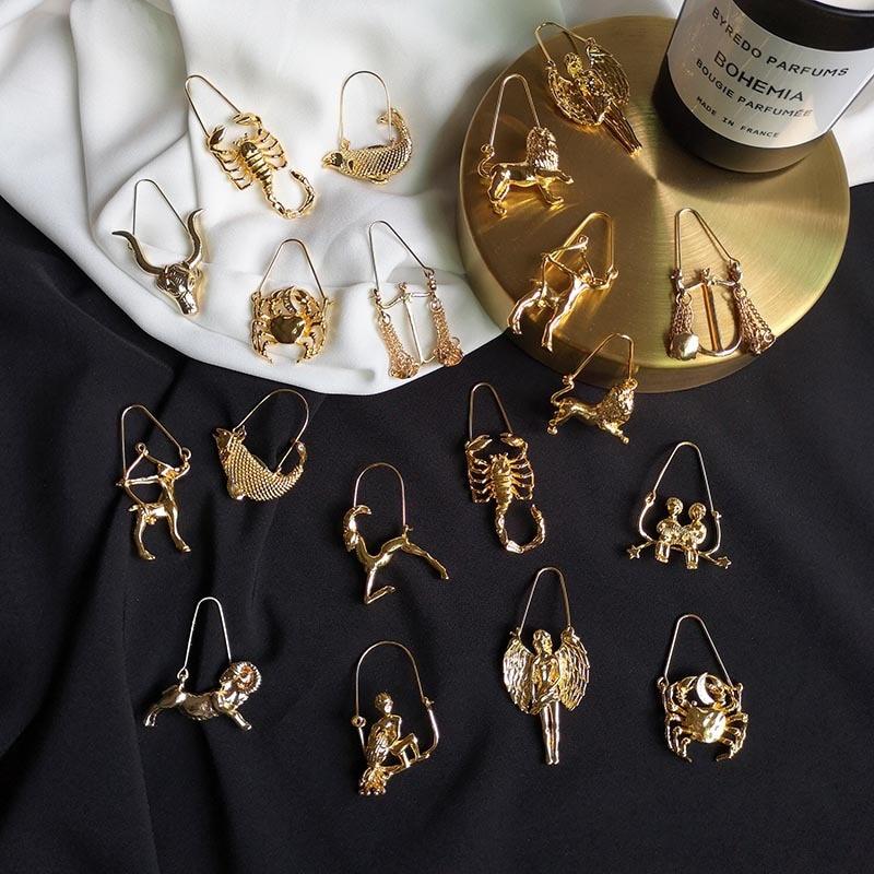 Nuevo diseño 12 Zodíaco de constelaciones pendientes de signo de aleación de color oro amarillo para mujer