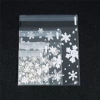 100pcslot merry christmas transparent snowflake gift bags cello bag self adhesive cookie bags for holidays party gift packaging