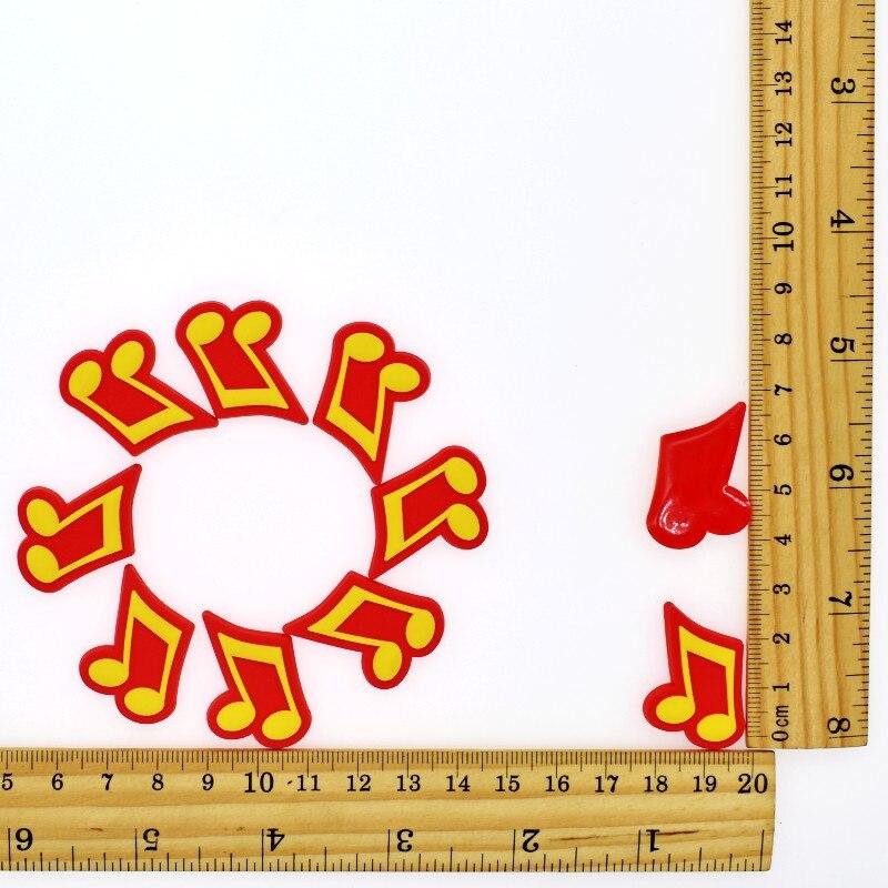 10 pces diy dos desenhos animados doraemon/símbolo da música/minion olhos/guita/pato/carros macio pvc artesanal acessórios presente