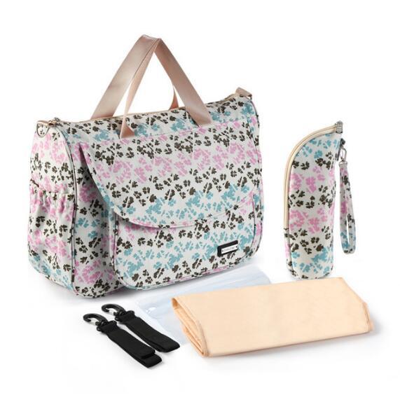 Nuevo bolso de bebé pañal bolsa mochila Desiger de bolsa de almacenamiento de viaje de cuidado de bebé con ganchos en cochecito