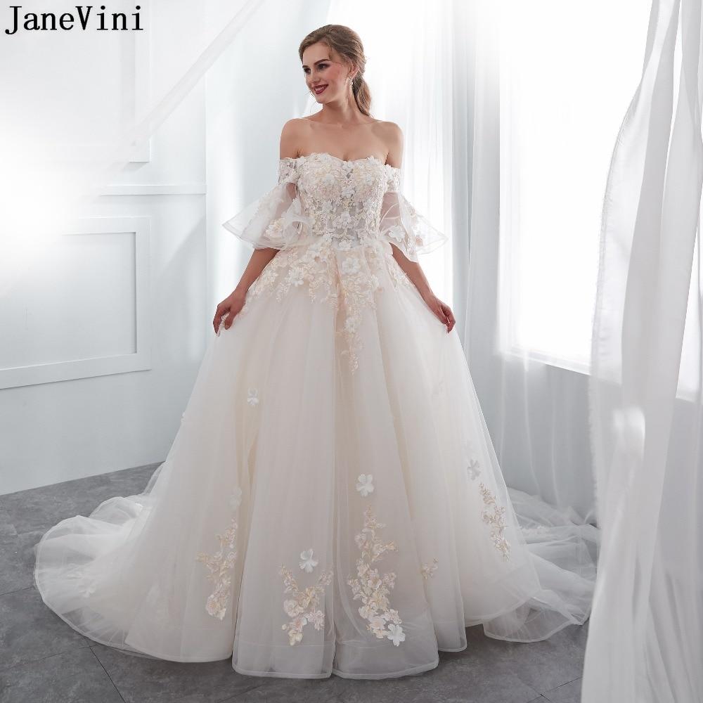 JaneVini encantadores vestidos largos de dama de honor de tul de champán...