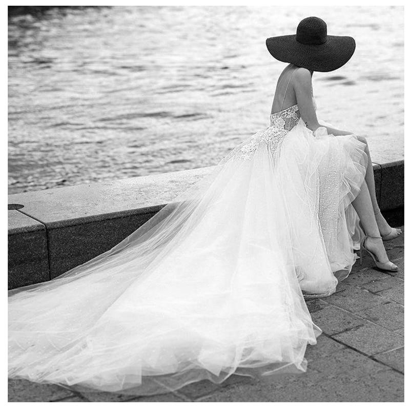 Купить с кэшбэком LORIE Princess Wedding Dress Spaghetti Straps Appliqued Flowers Bride Dress Long Train Tulle Backless Boho Wedding Gown