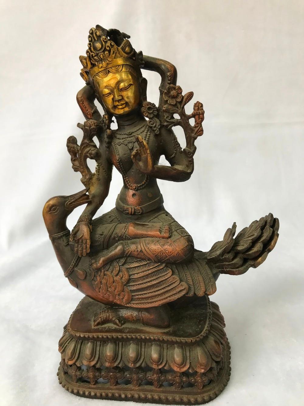 Estatua de bronce Tíbet chino Guan Yin kwan-yin Bodhisattva Diosa en estatua de pato Buda decoraciones para el hogar