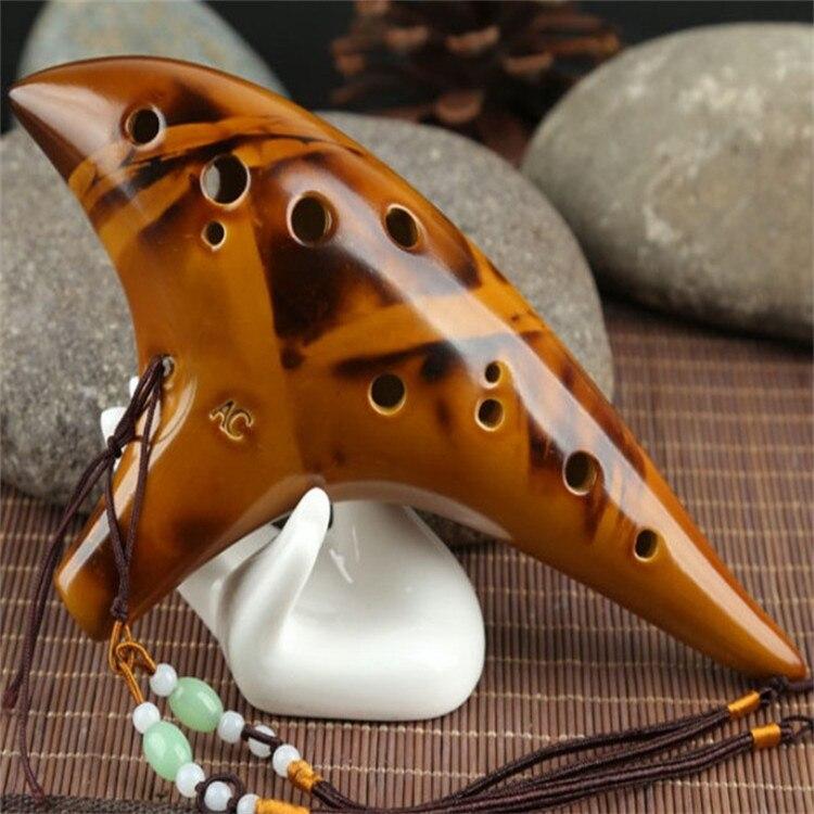 Twelve Kong Tao flauta alto C smoldered ocarina AC/flauta de enseñanza especializada de 12 agujeros para enviar materiales al por mayor