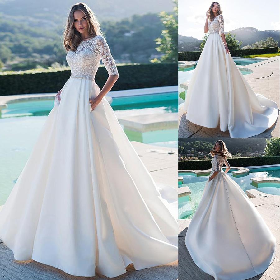 فستان زفاف ساتان غير لامع رائع ، خط رقبة على شكل أرجوحة ، نصف كم ، دانتيل ، مع جيوب