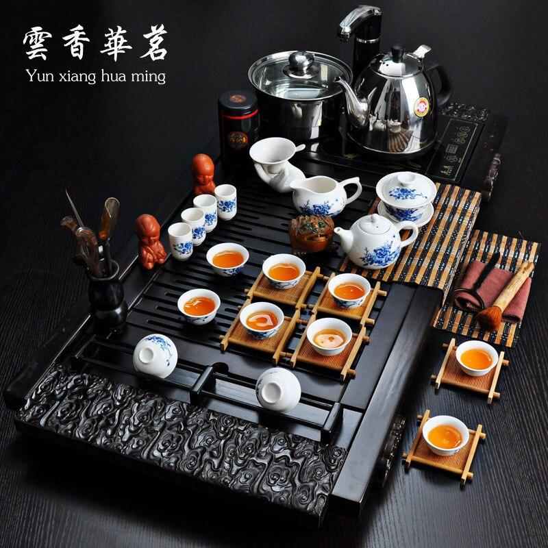 طقم شاي سيراميك طقم خاص من شاي الكونغ فو ثلاثة أو أربعة في واحد صينية فرن كهرومغناطيسية خشبية