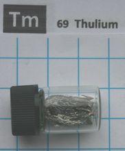 1 gramos 99.99% piezas de metal de Thulium en el elemento vial de vidrio 69 muestras